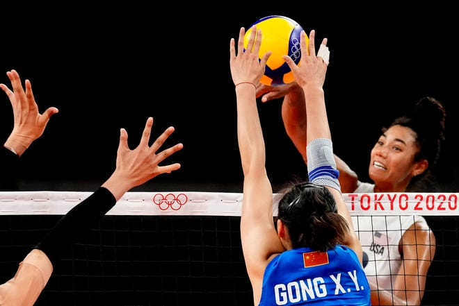 United States' Jordan Thompson, right, hits the ball during the women's volleyball preliminary round pool B match between China and United States at the 2020 Summer Olympics, Tuesday, July 27, 2021, in Tokyo, Japan.