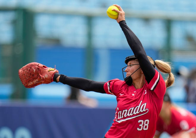 Canada's Lauren Regula pitches during the softball game between the United States and Canada at the 2020 Summer Olympics, Thursday, July 22, 2021, in Fukushima , Japan. (AP Photo/Jae C. Hong)