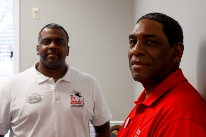 Aaron Morton, CEO and listing agent, left, and Mark Kelly, owner of the office and newly elected chair of the chamber of commerce, right, pose for a portrait in their office at the Air Assault Team, Keller Williams offices in Clarksville, Tenn., on Friday, July 23, 2021.
