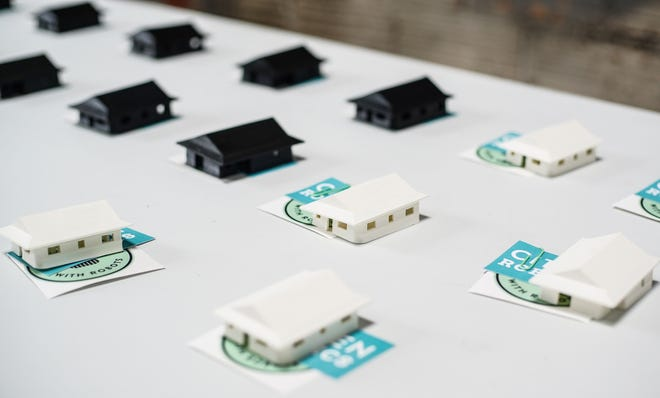 Small plastic houses manufactured at Citizen Robotics in Detroit sit on display during a press conference on July 27, 2021. Governor Whitmer announced a $100 million plan to boost affordable housing in Michigan.