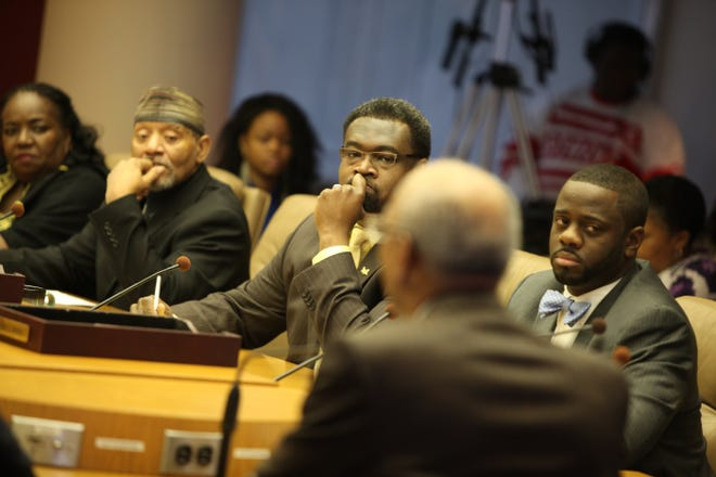 Detroit Mayor Dave Bing talks about his financial and operational restructuring plan with the Detroit city council on Jan. 5, 2012. From left are JoAnn Watson, Kwame Kenyatta, James Tate and Andre Spivey.