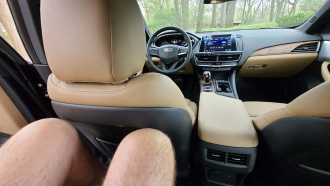 """With the biggest rear seat in class, the 2021 Cadillac CT5 fit 6'5"""" Detroit News auto critic Henry Payne comfortably."""