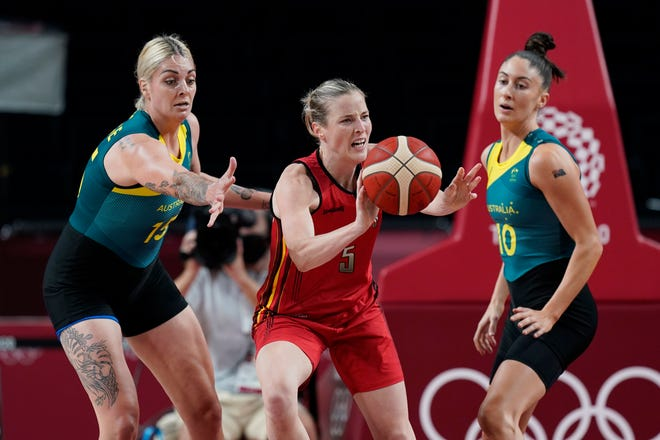 Belgium's Kim Mestdagh (5) moves the ball past Australia's Cayla George (15) during a women's basketball game at the 2020 Summer Olympics, Tuesday, July 27, 2021, in Saitama, Japan. (AP Photo/Eric Gay)