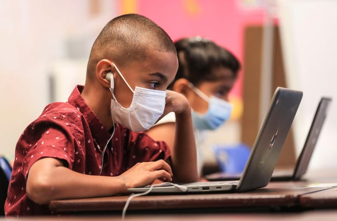 Students wear masks while attending a summer session at Zachary Taylor Elementary School on Tuesday, July 27, 2021. Superintendent Dr. Marty Pollio is recommending universal masking for students and staff when JCPS resumes classes in August for the 2021-2022 school year.