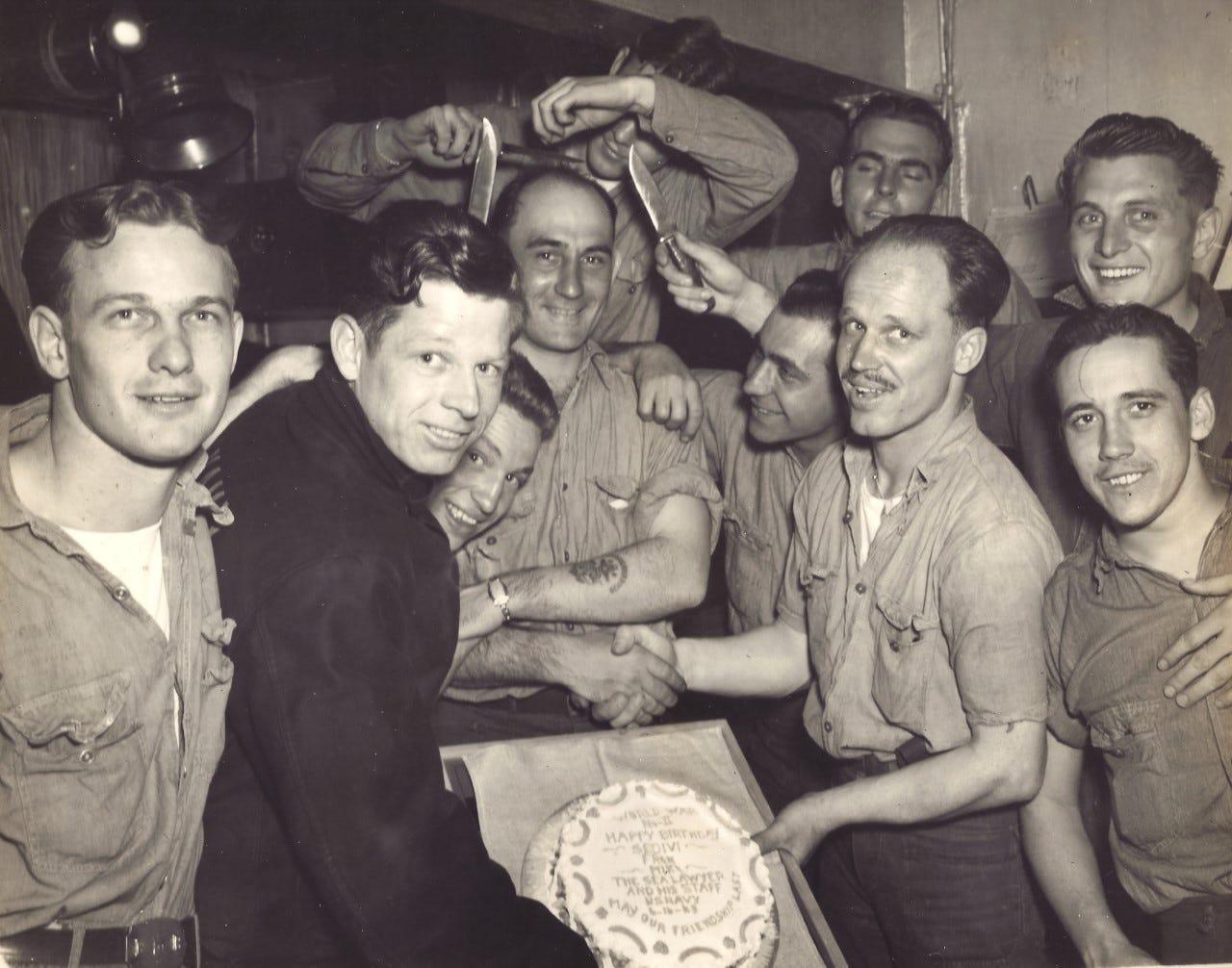 Crewmen of the USS Indianapolis gather to celebrate Alfred Sedivi's birthday.