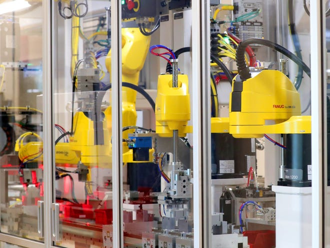 Robotic arms make components at the new production line at Rockwell Automation on South 2nd Street in Milwaukee on Tuesday, July 27, 2021.