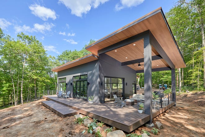 The outdoors blends with the indoors via large windows and glass doors at the Getaway, a vacation home outside Weyerhaeuser built by the staff of Family Handyman magazine.