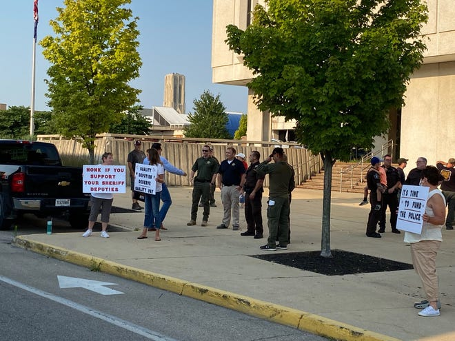 About 40 Delaware County deputies, jailers and their supporters rallied in support of pay raises Tuesday morning at the downtown County Building.