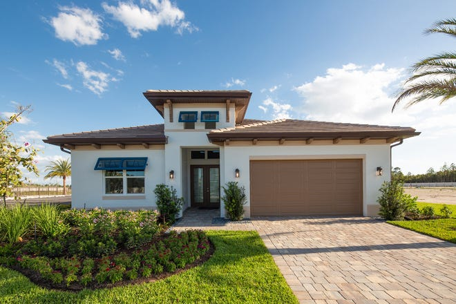 The Cedar Key model at Sapphhire Cove, shown here as a previous model, features a design with a dramatic double door entry and open floor plan.