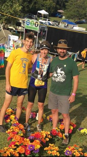 Farmington mayor Sara Bowman poses with her son Nate and her husnabd John after her 50-mile run in Pinckney.