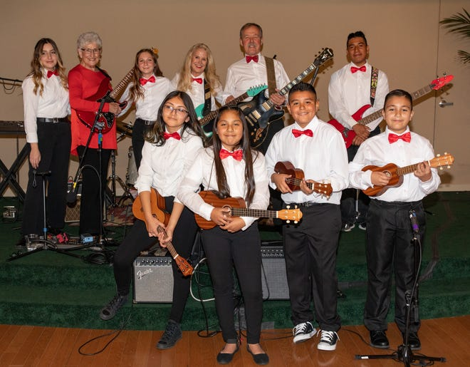 """Performing at a February 2020 Bravo Children in Music fundraiser for Steinway are (front) """"Ukesters"""" Nicole Castro, Jacquelyn Solares-Vallejo, Isaiah Munos and Gael Martinez along with (back) Lauren Varela, Steinway Founder Ruth Moir, Gaia Calderon, ukulele teacher Jeanie Cunningham, special guest Hoot Gibson, and Angel Torres."""