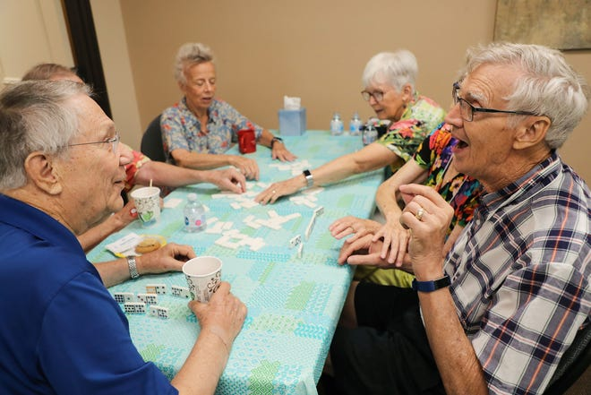 A group plays dominos at Alzheimers Coachella Valley, Tuesday, July 27, 2021.  Alzheimers Coachella Valley  provides support for Coachella Valley residents living with cognitive impairment.