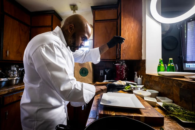 Chef Christopher Moore, owner of Chef Chris Catering, LLC, works to prepare a meal Monday, July 26, 2021, in his Port Huron home. Moore was born in Detroit and moved to Port Huron in 2015.