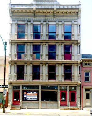 A building which formerly housed Rudy Art Glass and The York Dispatch, at 15 E. Philadelphia St. in York City, Tuesday, July 27, 2021, is for sale. Bill Kalina photo
