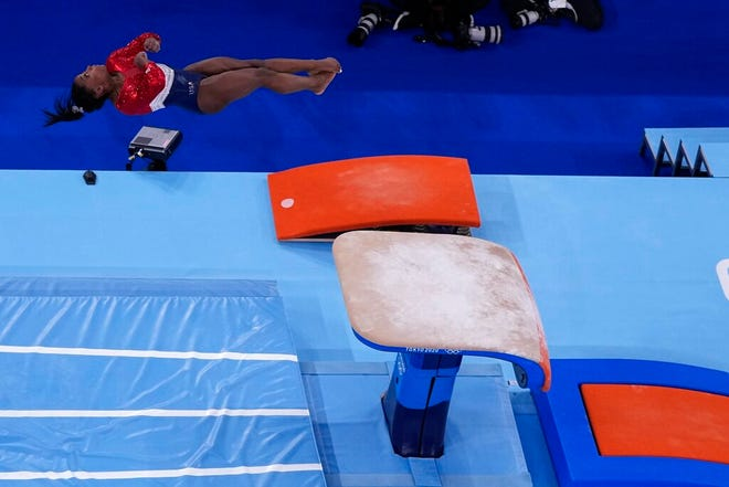 Simone Biles, of the United States, performs on the vault during the artistic gymnastics women's final at the 2020 Summer Olympics, Tuesday, July 27, 2021, in Tokyo. (AP Photo/Morry Gash)