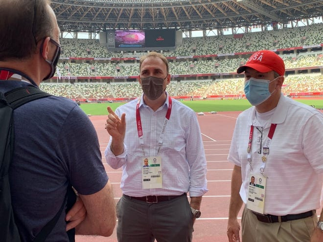 Supervisory Special Agent and Deputy Assistant Director Galen Nace (middle) and Deputy Assistant Secretary Mark Sullo (right) meet with a Diplomatic Security Service field liaison officer serving at the Tokyo Olympics, Olympic Stadium, on Monday, July 26, 2021.