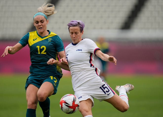 United States' Megan Rapinoe, right, and Australia's Ellie Carpenter battle for the ball during a women's soccer match at the 2020 Summer Olympics, Tuesday, July 27, 2021, in Kashima, Japan. Rapinoe is a Palo Cedro native and has a street named after her at the California Soccer Park in Redding.