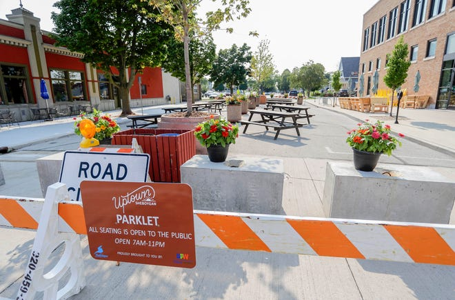 A section of St. Clair Ave. has been converted into a parklet as seen, Tuesday, July 27, 2021, in Sheboygan, Wis.