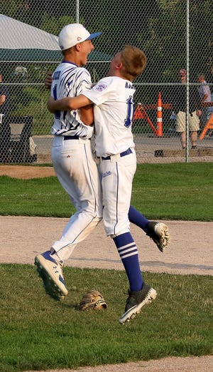 Sioux Falls Little League All Stars Gavin Weir and Beau Koerner celebrate winning the South Dakota State Championship over Rapid City - Harney. The team is undefeated in post-season play.