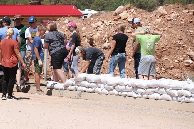Clean up efforts are under way in Cedar City after the mayor declared a state of emergency, July 27.