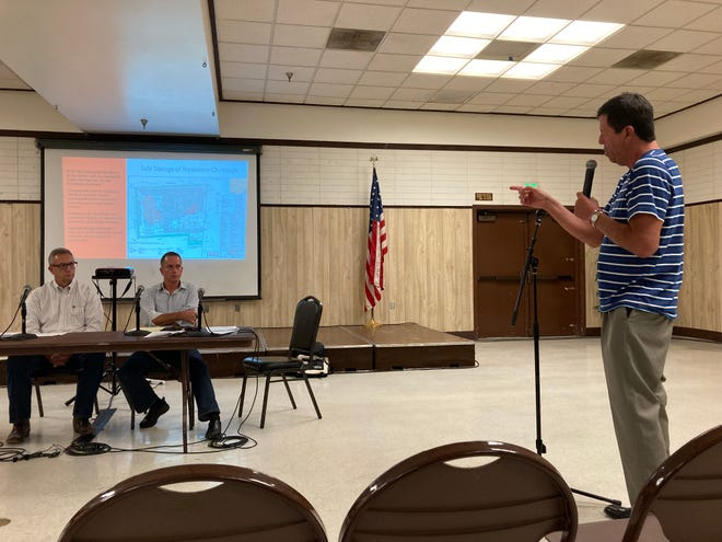 Timothy Koziol, RI-NU Services CEO, from left, and Rob Dal Farra, Sespe Consulting, Inc. vice president, listen to Santa Paula resident John Bravo at a community forum about the potential reopening of an industrial waste plant at the Santa Paula Community Center on Monday, July 26, 2021.