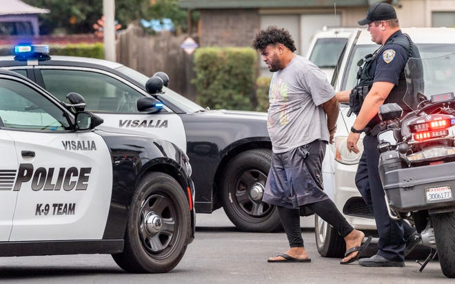 Visalia Police take Afutiti Laumau, 39, into custody Monday, July 26, 2021 after a domestic violence call. Police responded just after 5 p.m. to a house in the 100 block of East Parkview Avenue for two victims struck with the handle of an axe. Soon after police found a van on East Walnut Avenue that matched the description given by the victims. An axe was taken from the victims residence.