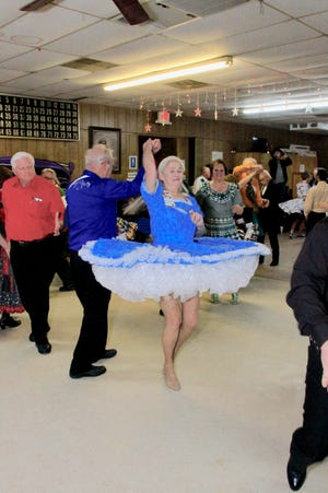 """Members of the Red River Square and Round Dancing Association practice their moves. The group will host a """"Roaring Twenties"""" dance this Saturday."""