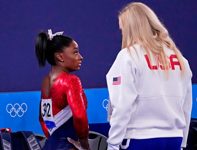 Simone Biles (USA) walks off the floor after the first rotation during the Tokyo 2020 Olympic Summer Games at Ariake Gymnastics Centre.