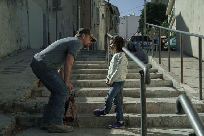 "Bill (Matt Damon) strikes up an instant friendship with young Maya (Lilou Siauvaud) in ""Stillwater."""