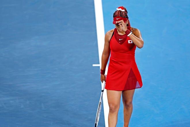 Naomi Osaka (JPN) reacts to her loss Marketa Vondrousova (CZE) in the women's tennis third round singles during the Tokyo 2020 Olympic Summer Games at Ariake Tennis Park.