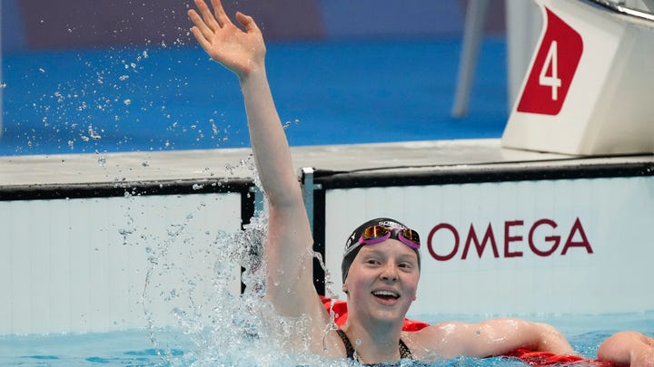 Lydia Jacoby (USA) celebrates after winning the women's 100m breaststroke final during the Tokyo 2020 Olympic Summer Games at Tokyo Aquatics Centre.