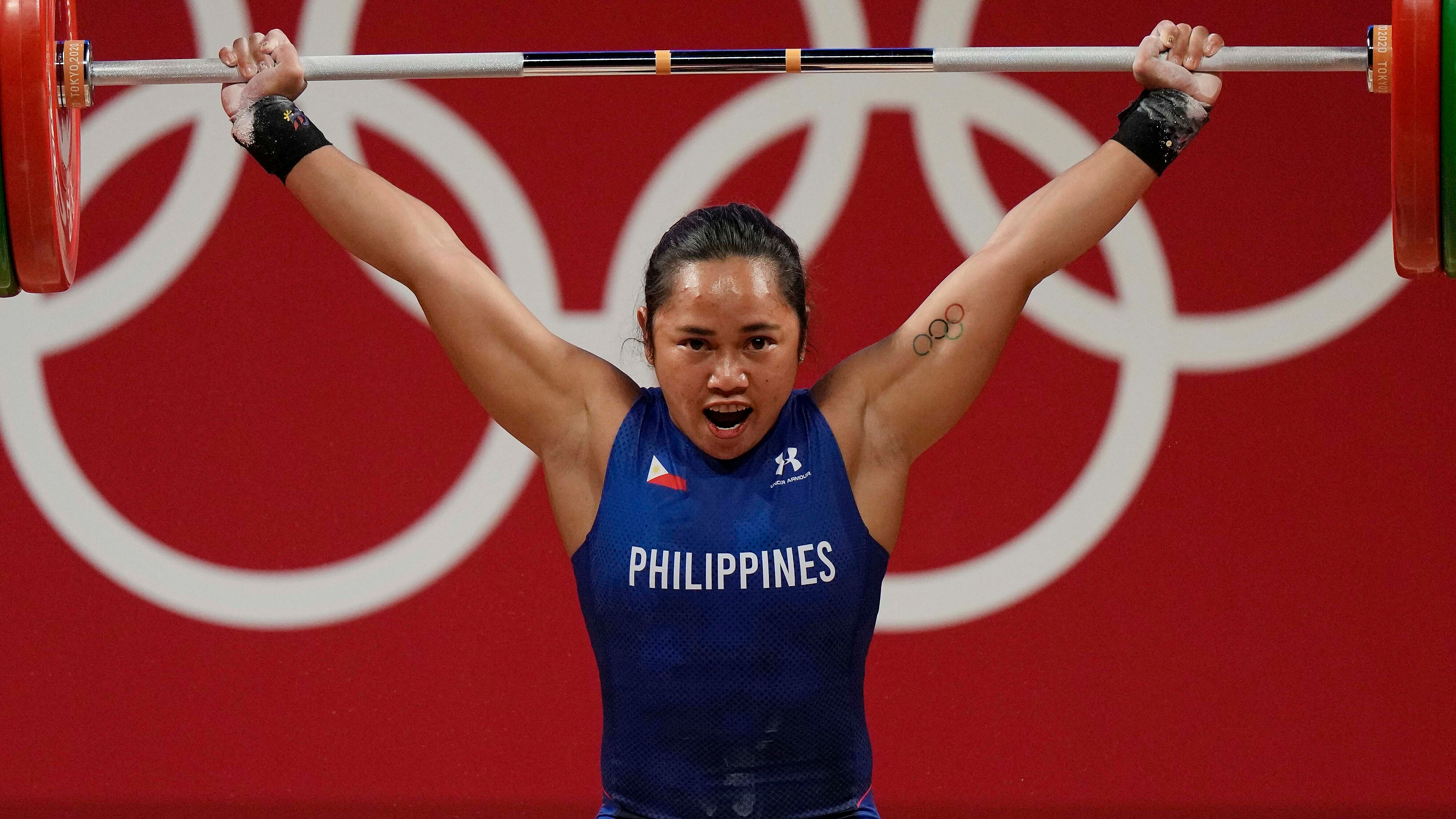 Weightlifter Hidilyn Diaz wins Philippines  first Olympic gold medal, 2 houses and $660,000