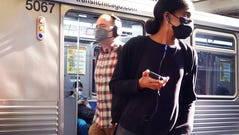 Commuters wearing face masks arrive in the Loop on an L train on July 27, 2021 in Chicago, Illinois.