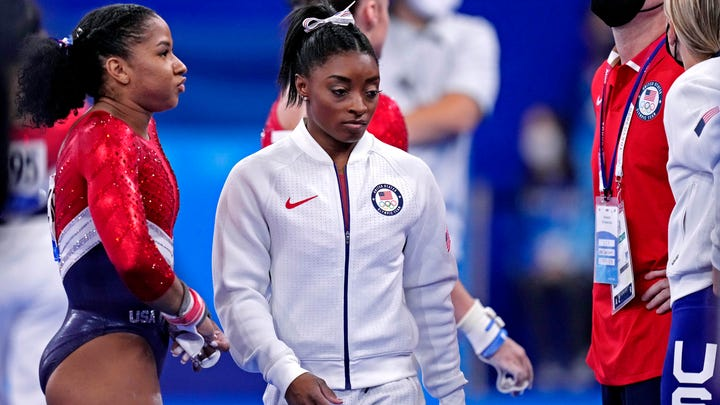 Simone Biles (USA) wears her warm up gear after competing on the vault during the Tokyo Olympics.