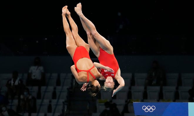 Jessica Parratto and Delaney Schnell compete in the women's 10-meter platform synchronized diving competition.