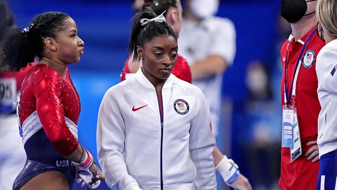 Olympic gymnast Simone Biles prioritized her need to step back and focus on her mental health amid the pressure of being one of the United States' premier athletes with high expectations for the Tokyo 2020 games.