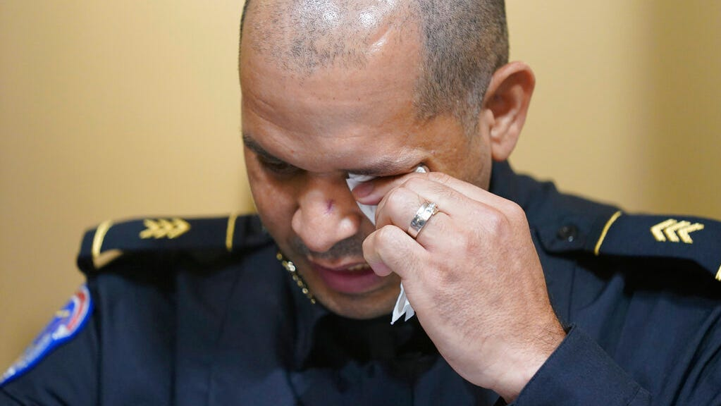Police describe 'desperate struggle' to hold back mob in emotional testimony to lawmakers