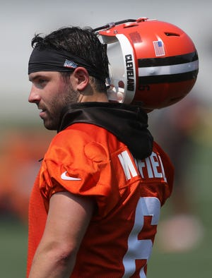 Cleveland Browns quarterback Baker Mayfield stands on the sideline during NFL football training camp, Wednesday, July 28, 2021, in Berea, Ohio.