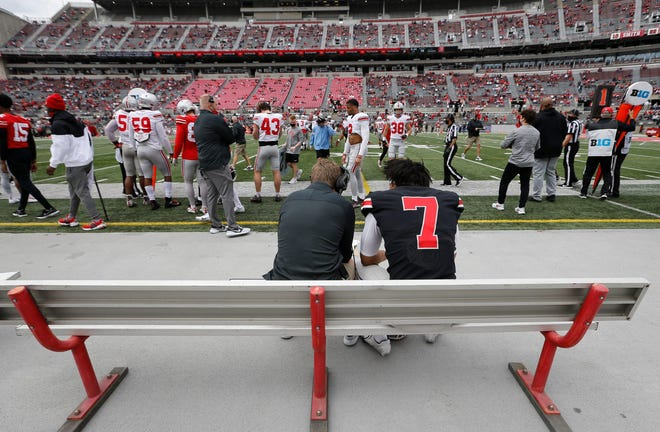 Ohio State quarterback C.J. Stroud talks to Buckeyes quarterbacks coach Corey Dennis during the team's spring game in April. With Justin Fields now in the NFL, Stroud is considered the front-runner for the Buckeyes' starting job.