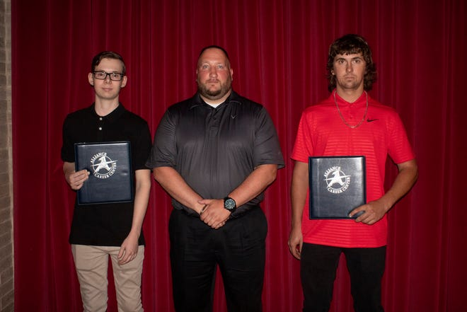 Ryan Brooks and Dustin Campbell were 2021 graduates of the Alliance Career Center welding program. With them is Michael Mariana, the welding instructor.
