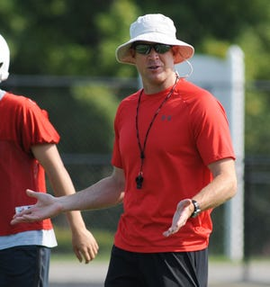 New Alliance football assistant coach Tim Mosher teaches during a scrimmage against Jackson Tuesday, July 27, 2021, at Len Dawson Field.