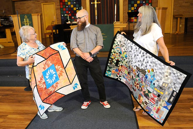 Old Uniontown Quilt Guild 2020 quilter of the year Deb Armstrong, left, and 2021 quilter of the year Sonya Riley talk with Christ United Methodist Church's Pastor Kyle Gould on Tuesday, July 27 while holding one of their quilts at the club's second monthly meeting at Christ United Methodist Church after a year off due to COVID. With around 20 to 25 members , Old Uniontown Quilt Guild meets the fourth Tuesday of the month at 7 p.m. at Christ United Methodist Church.