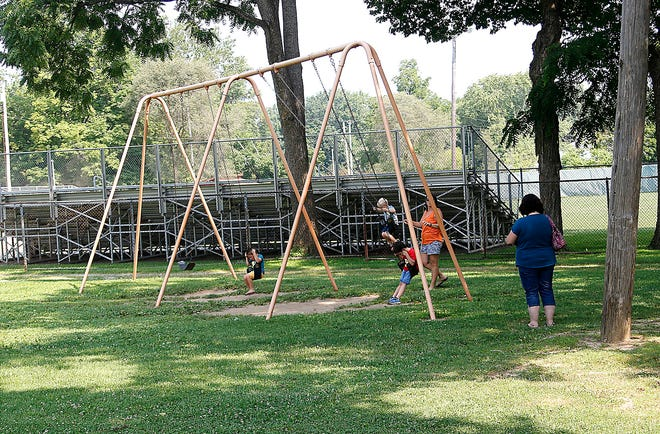 People enjoy the playground Wednesday at Brookside Park in Ashland County, one of 23 Ohio counties on the CDC's list of counties with substantial or high transmission rates for COVID-19.