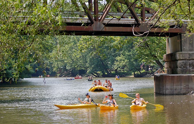 People head down the Mohican River near the Spellacy Bridge on Wally Road on Wednesday, July 28, 2021. TOM E. PUSKAR/TIMES-GAZETTE.COM
