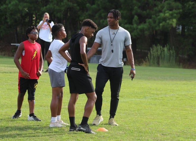 Georgia Southern defensive back Derrick Canteen hosted a free, youth football camp at his alma mater Evans High School on Tuesday. The All-American was joined by new Evans Coach Barrett Davis and a host of former Columbia County football players to coach more than 60 children.