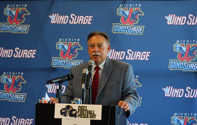 Kansas Jayhawk Community College Conference Commissioner Carl Heinrich speaks at the annual KJCCC Media Day at Riverfront Stadium, Home of the Wichita Windsurge in Wichita, Kansas on Wednesday, July 28.