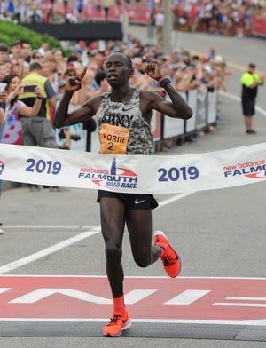 Leonard Korir crosses the finish line, winning the Falmouth men's division in 2019.
