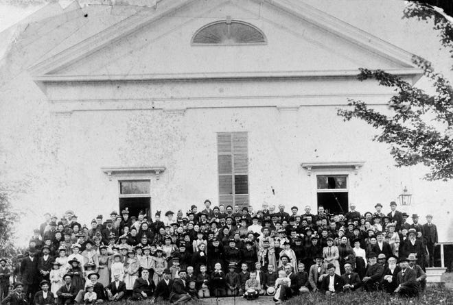 The proud congregation of the Milo Center Methodist Church poses for a picture in 1895. In 1902 their beloved church building burned.