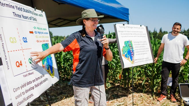 Quirine Ketterings, professor of animal science in CALS, connects with farmers about crop yields during a 2018 extension event at the Aurora Research Farm.