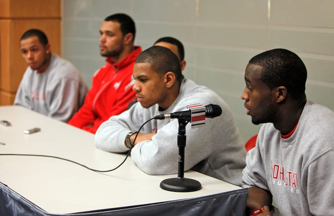 """(osufb sorry 12-29 GORDON LEWIS 12/28/2010) Ohio State football players who were served five-game suspensions last week for NCAA violations apologized to """"Buckeye Nation"""" in the Woody Hayes Athletic Center Tuesday, December 28, 2010. (from left) DeVier Posey, Mike Adams, Daniel Herron (hidden), Terrelle Pryor and Solomon Thomas all were suspended for the first five games of the 2011 season for violations including the selling of memorabilia. (Dispatch photo by Shari Lewis)"""